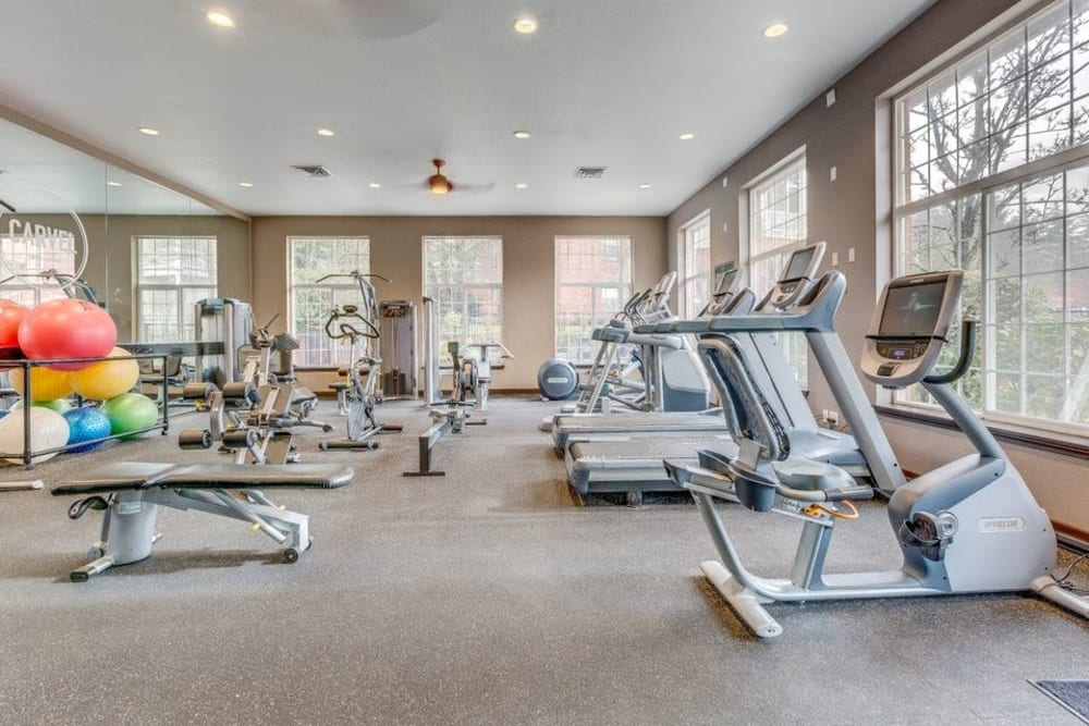 Cardio machines and weight machines in fitness room at Carvel Harbour Pointe in Mukilteo, WA