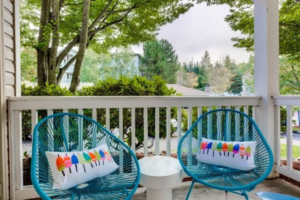 Outdoor furniture in private balcony at Carvel Harbour Pointe in Mukilteo, WA