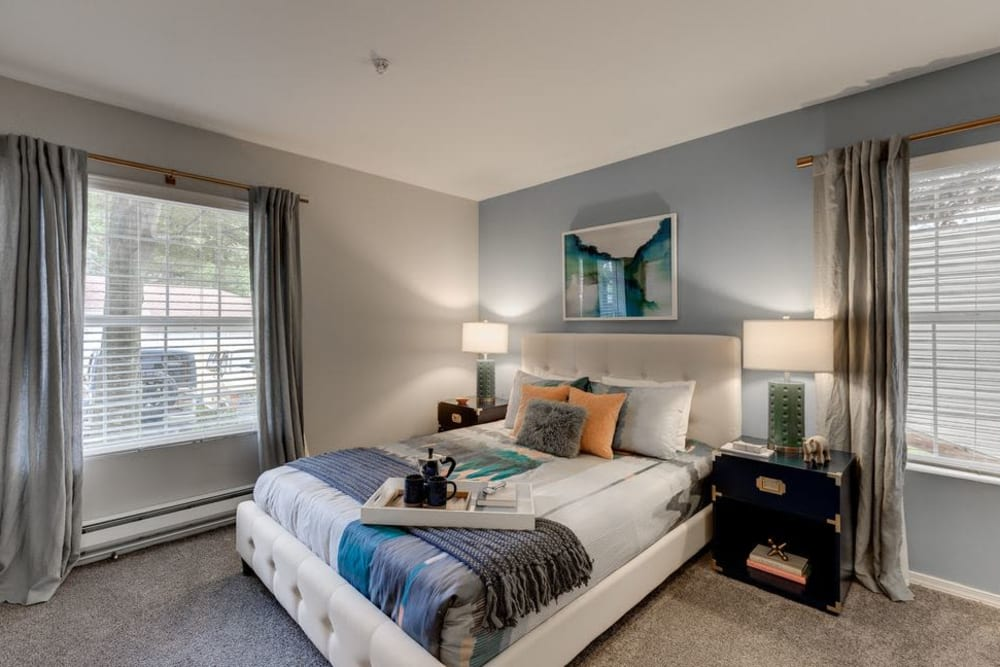 Carpeted master bedroom with large windows at Carvel Harbour Pointe in Mukilteo, Washington