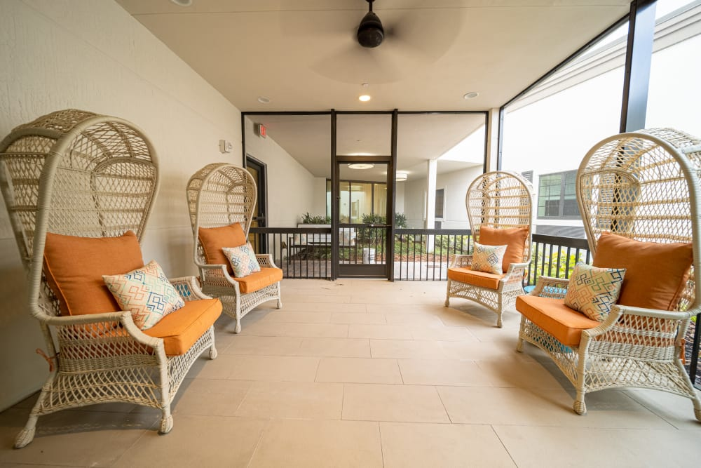 Enjoy the balmy breezes on the screened-in porches at Inspired Living Delray Beach in Delray Beach, Florida
