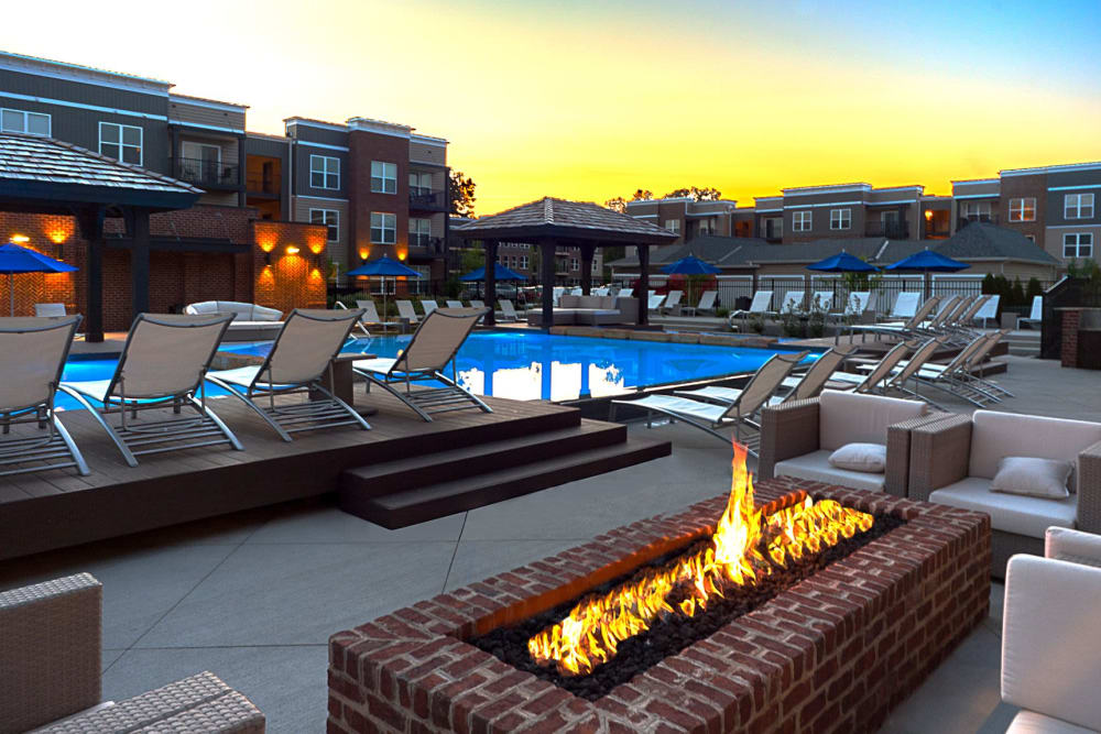 Fireplace and lounge area next to the pools at Palmer House Apartment Homes in New Albany, Ohio