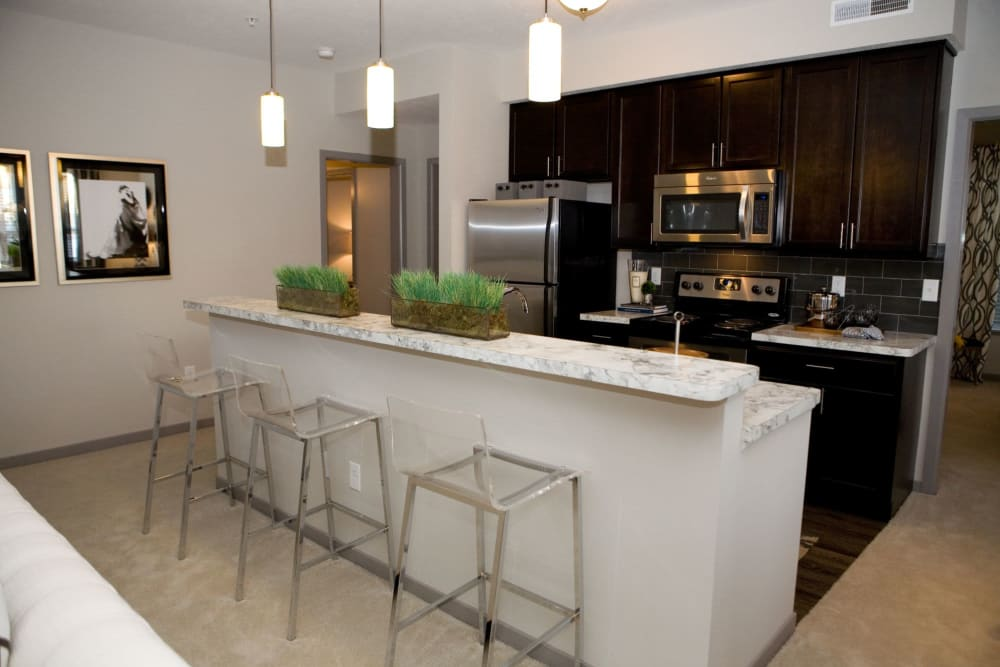Bar seating area and community kitchen at Palmer House Apartment Homes in New Albany, Ohio