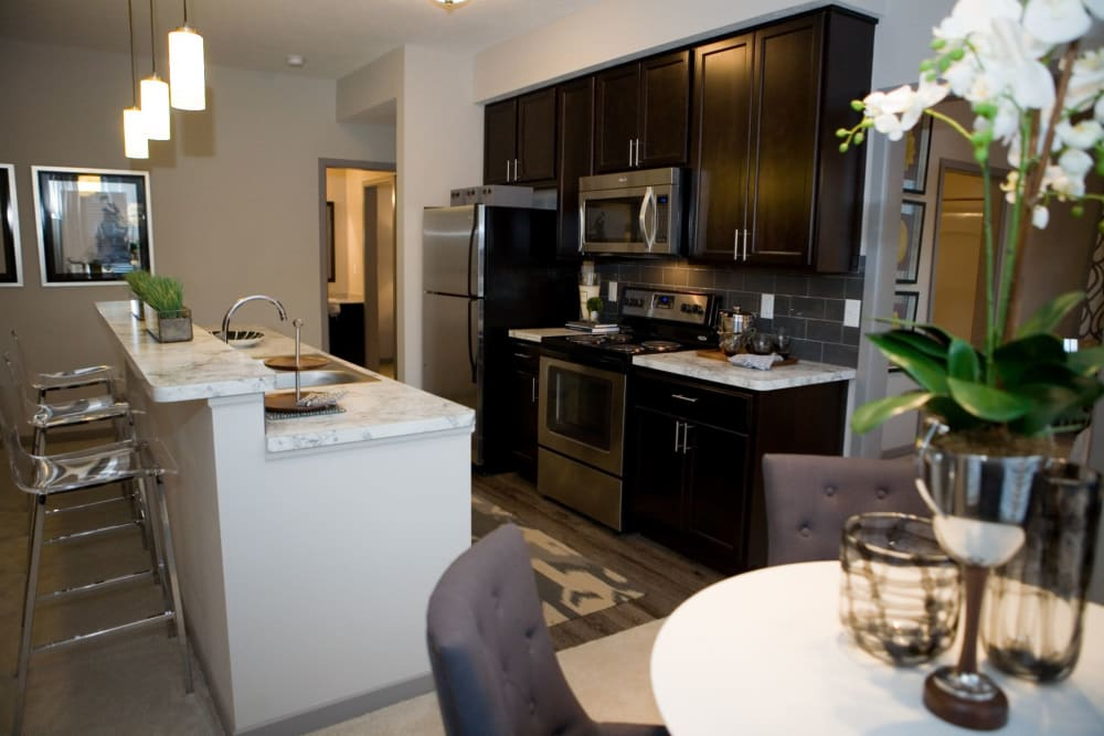 Side view of bar seating area and community kitchen at Palmer House Apartment Homes in New Albany, Ohio