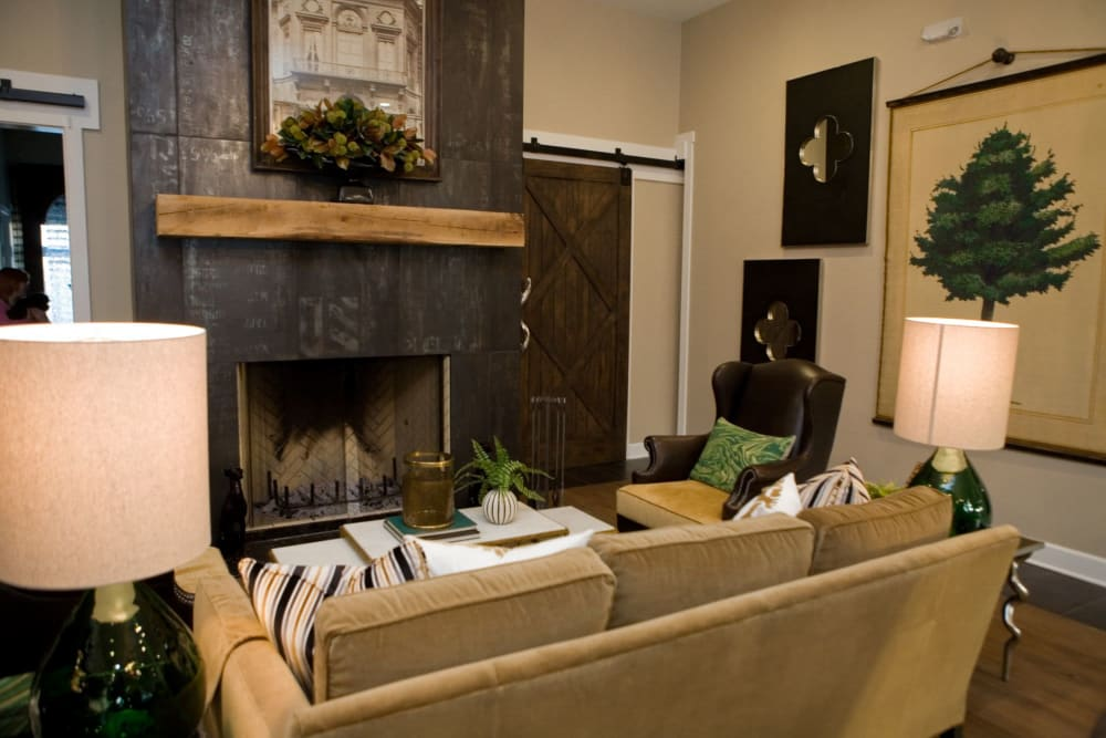 Seating area next to fireplace at Palmer House Apartment Homes in New Albany, Ohio