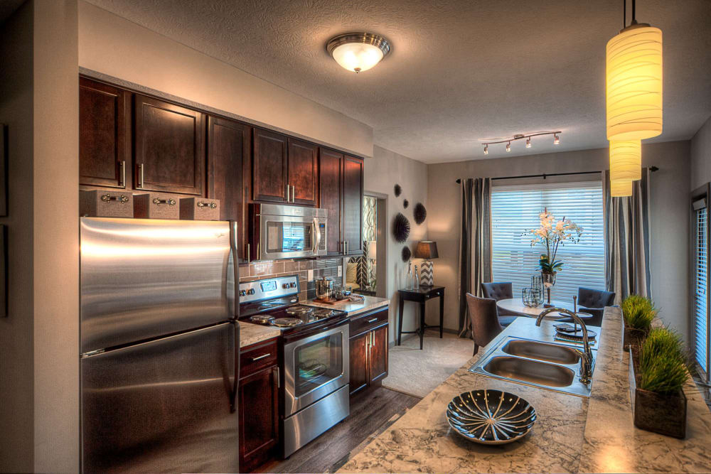Kitchen in model apartment with great lighting at Palmer House Apartment Homes in New Albany, Ohio