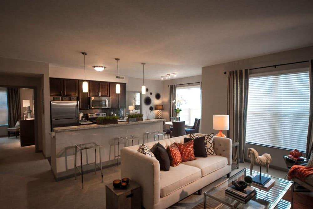 Model apartment living room with plenty of natural lighting at Palmer House Apartment Homes in New Albany, Ohio