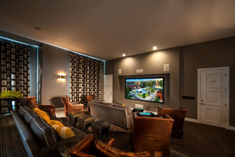 Movie theater with comfortable seating at Palmer House Apartment Homes in New Albany, Ohio
