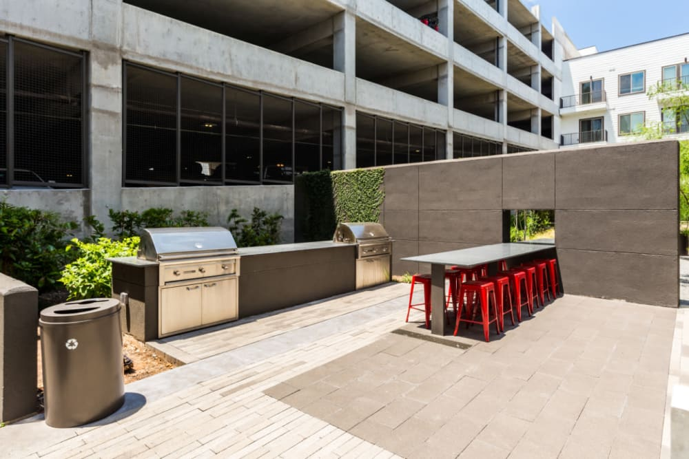 Stainless steel BBQs with long dining stable and stools at Marq on Burnet in Austin, Texas