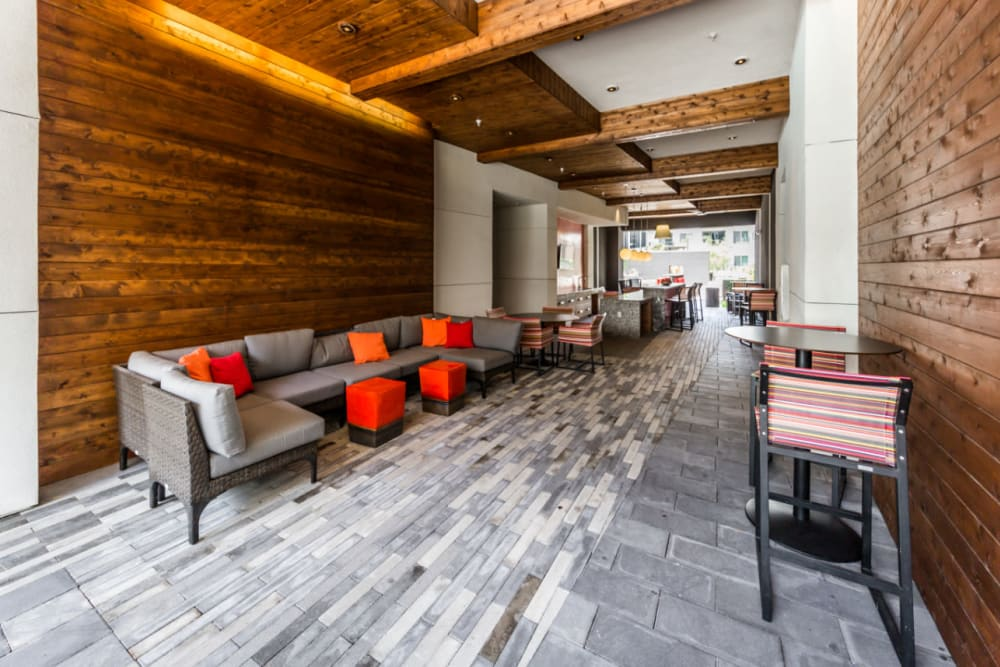 Thruway with lounge couches and dining bar tables and chairs at Marq on Burnet in Austin, Texas