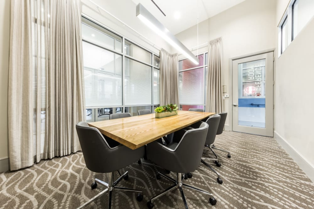 Private meeting room with large table and roller chairs at Marq on Burnet in Austin, Texas