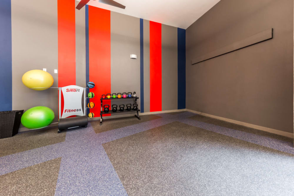 Kettlebell and medicine ball station in yoga room at Marq on Burnet in Austin, Texas