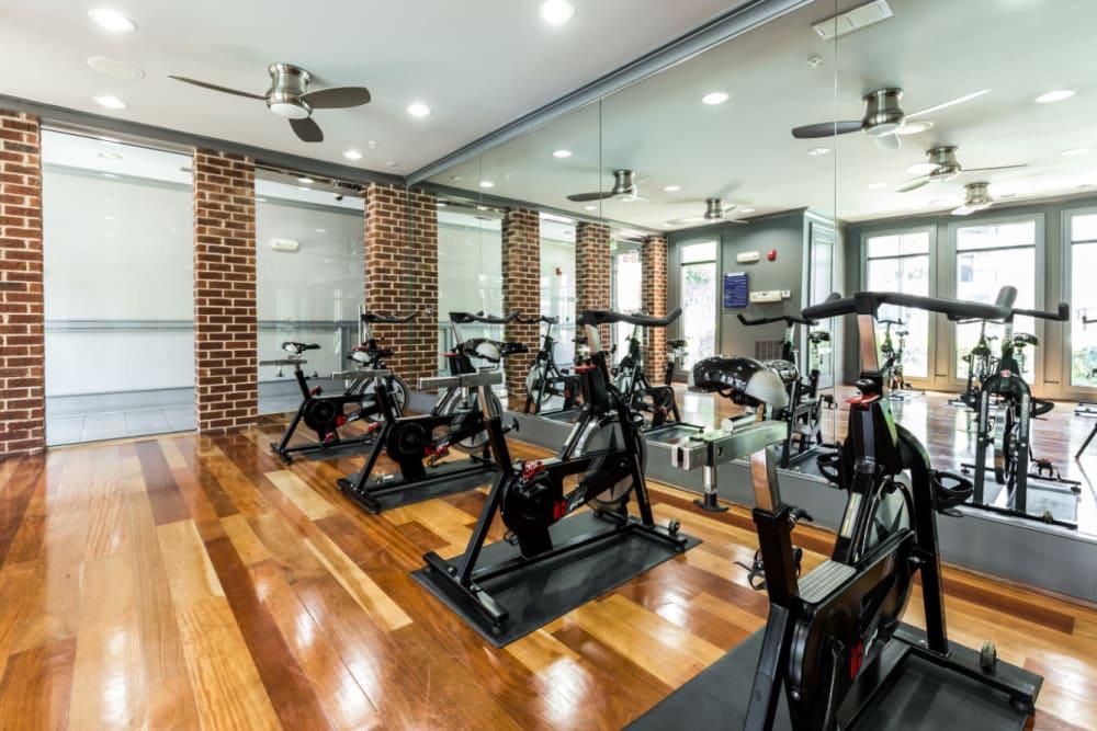 Spin cycles facing mirrors at Marquis Midtown District in Atlanta, Georgia
