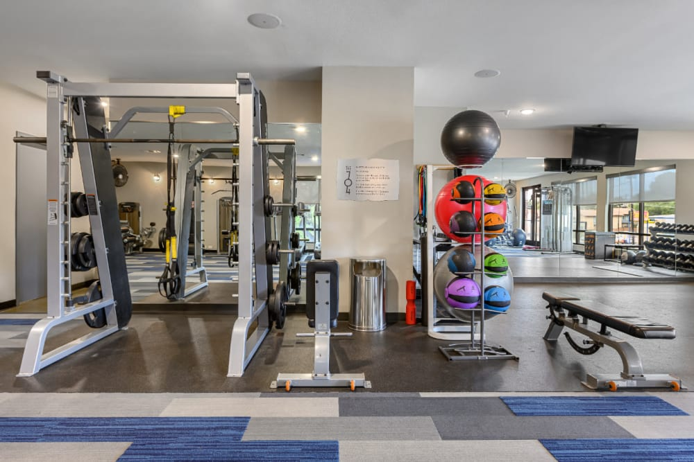 Large windows facing pool deck in private fitness room at The 704 in Austin, Texas