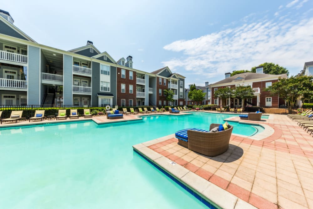 Lounge chairs alongside resort style swimming pool at The Marq at Brookhaven in Atlanta, Georgia