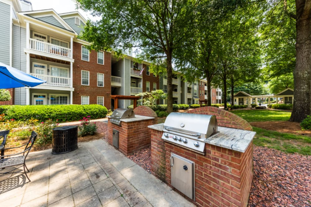 Propane gas BBQ grills set in brick with granite countertops at The Marq at Brookhaven in Atlanta, Georgia