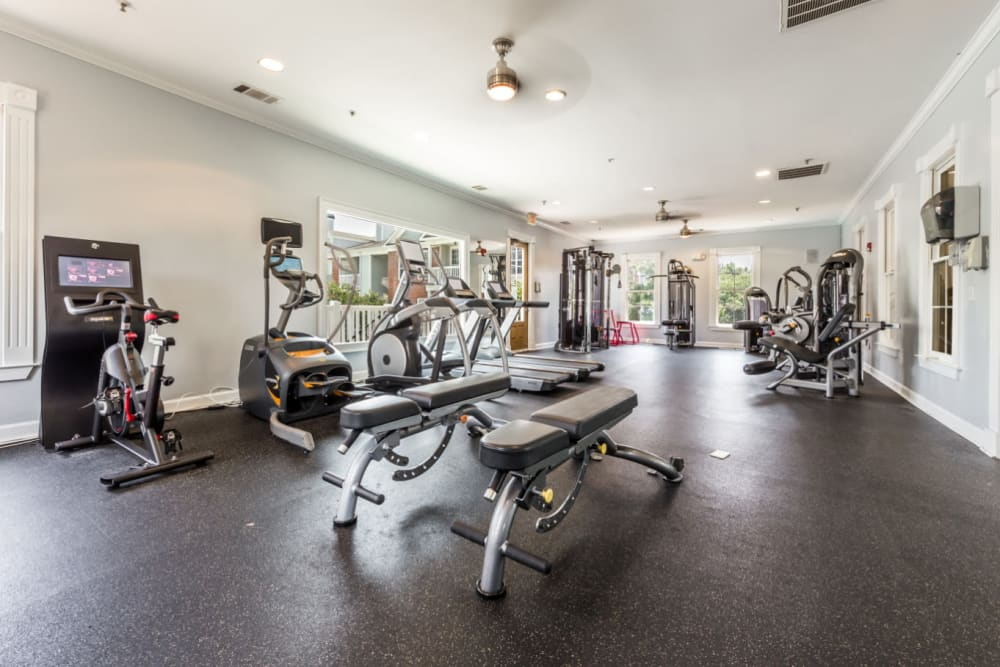 Cardio machines, benches, and assisted weight machines in fitness room at The Marq at Brookhaven in Atlanta, Georgia