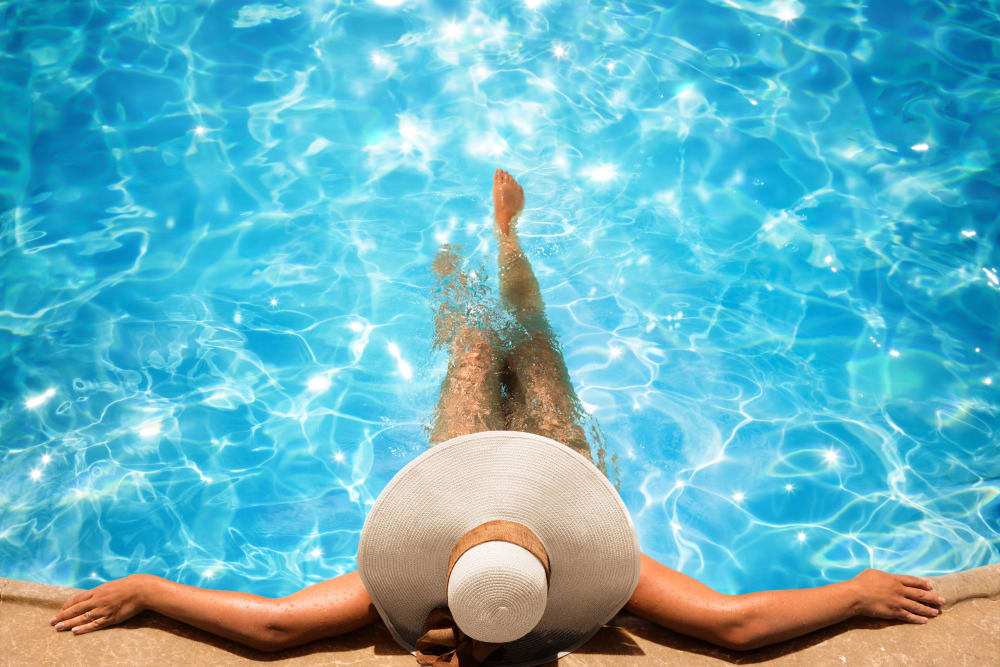 Woman at the edge of the pool relaxing at The Residences at Sawmill Station in Morton Grove, Illinois