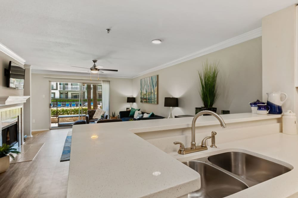 Massive kitchen and living room with gorgeous white countertops at 45Eighty Dunwoody Apartment Homes in Dunwoody, Georgia