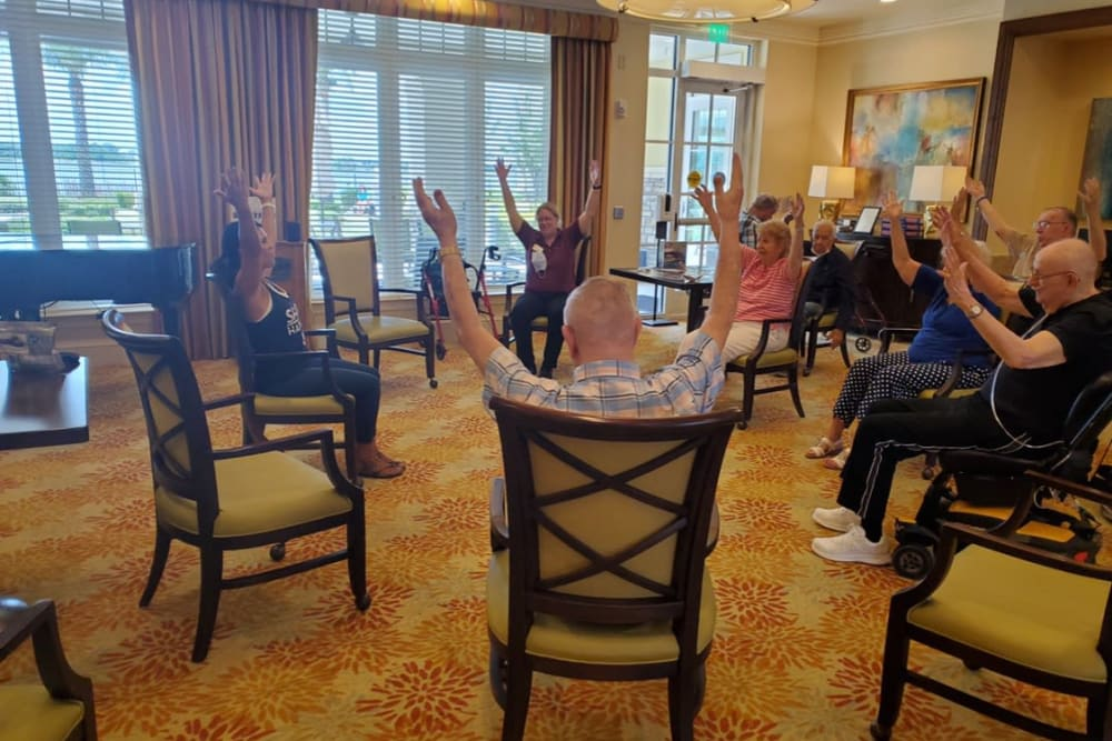 Residents in fitness studio exercising at Azpira at Windermere