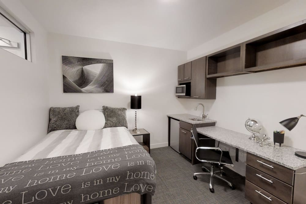 Furnished bedroom and nice desk area to work on school work at The View on Pavey Square in Columbus, Ohio
