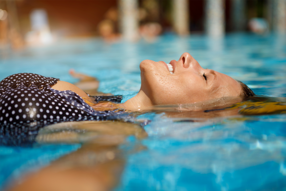 Floating in the pool and soaking up the sun at The Residences at Sawmill Station in Morton Grove, Illinois