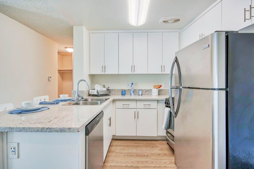 Granite countertops in a model home's kitchen at Villa Vicente in Los Angeles, California