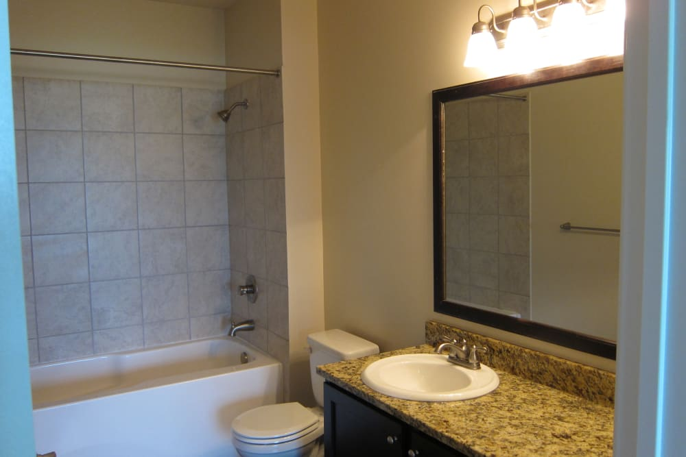 Large mirror in a restroom in Aspen Pines Apartment Homes in Wilder, Kentucky
