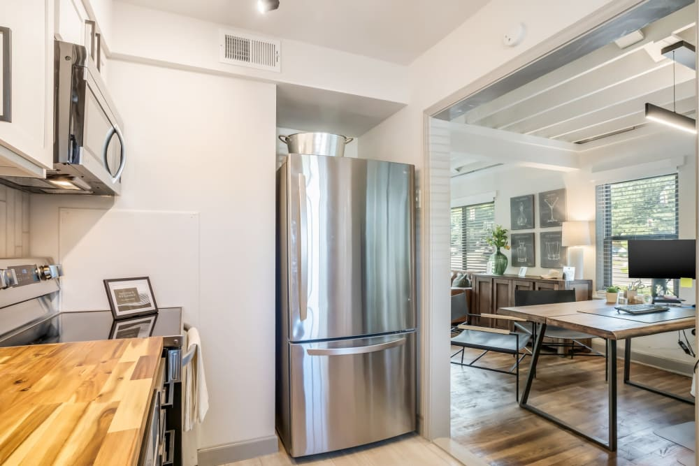 Kitchen with stainless steel appliances at Kiwi Goji Apartments in Memphis, Tennessee