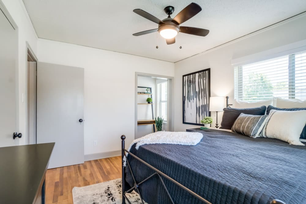 Bedroom with wood-style flooring at Kiwi Goji Apartments in Memphis, Tennessee