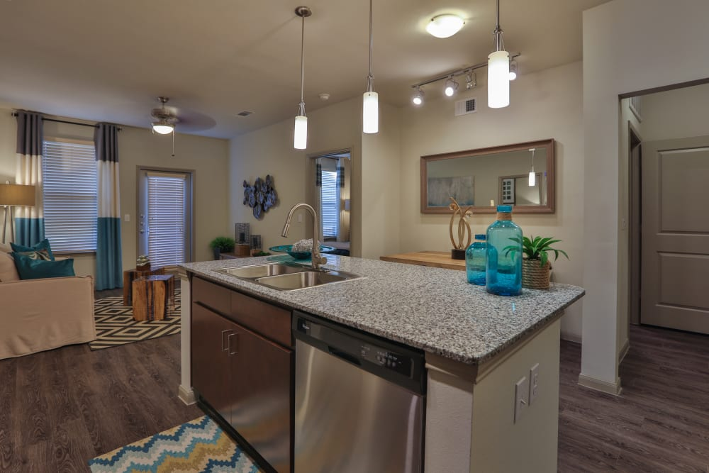 Kitchen with ample counter space at Olympus at Waterside Estates in Richmond, Texas