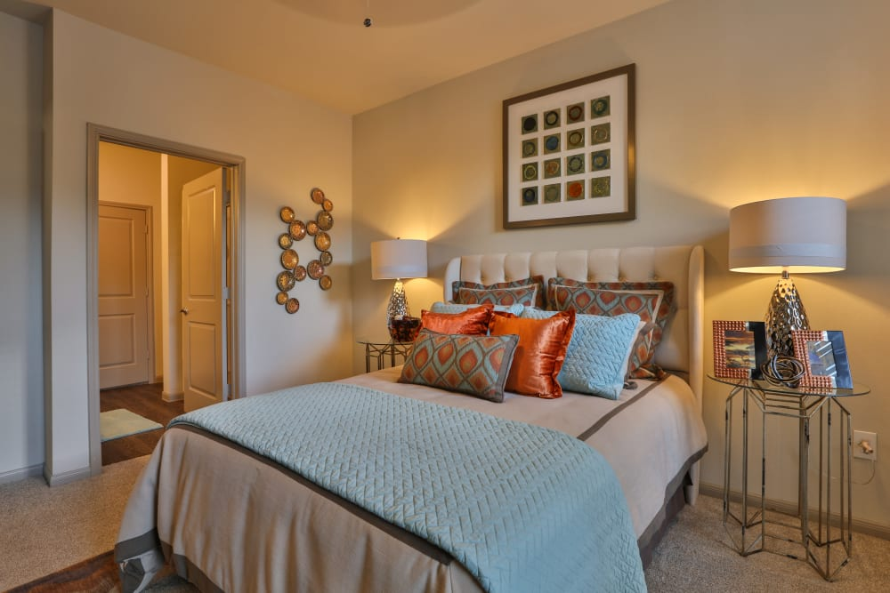 Model apartment master bedroom at Olympus at Waterside Estates in Richmond, Texas