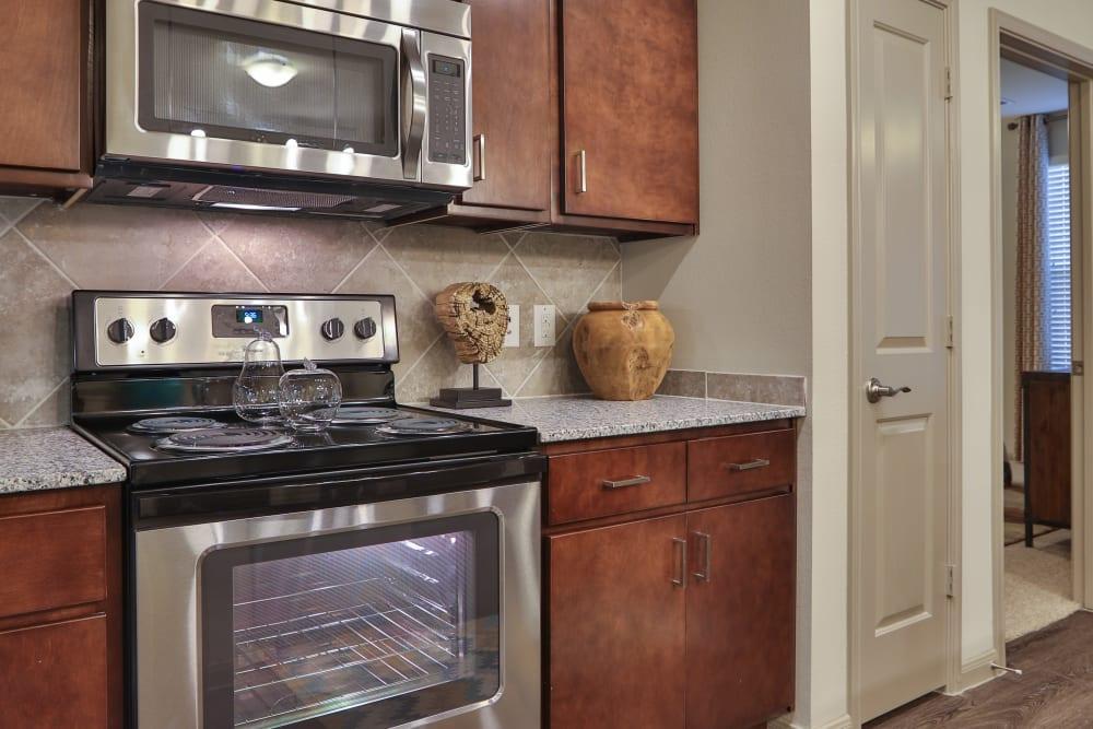 Stainless steel kitchen appliances at Olympus at Waterside Estates in Richmond, Texas