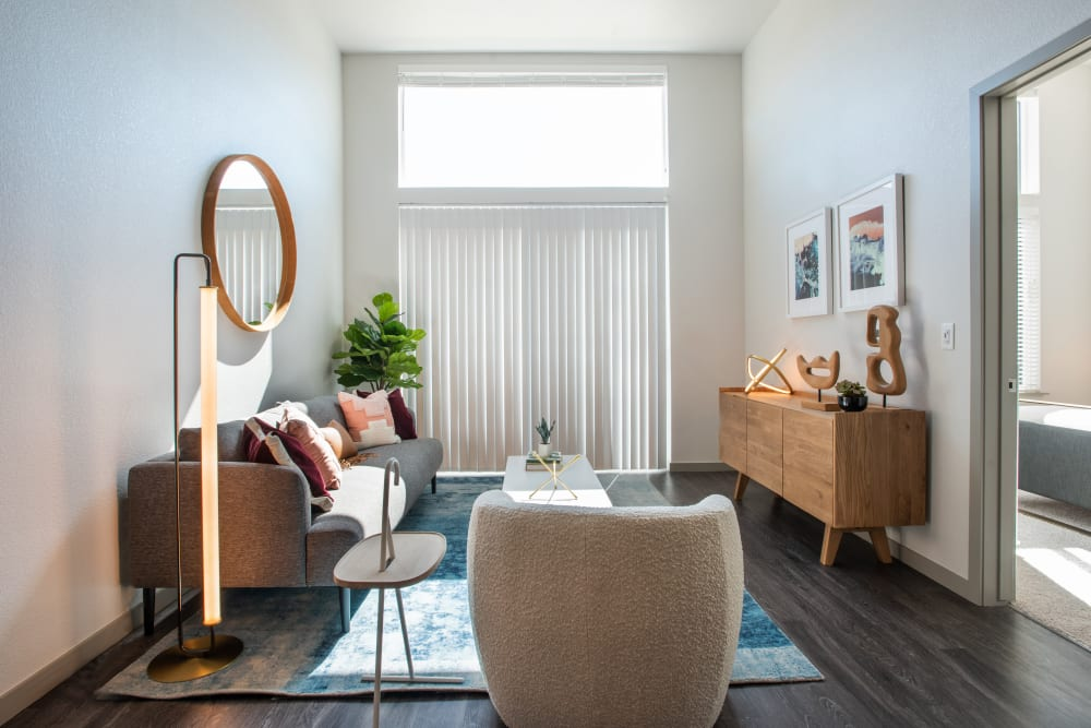Living room with wood style flooring at Marq Iliff Station in Aurora, Colorado
