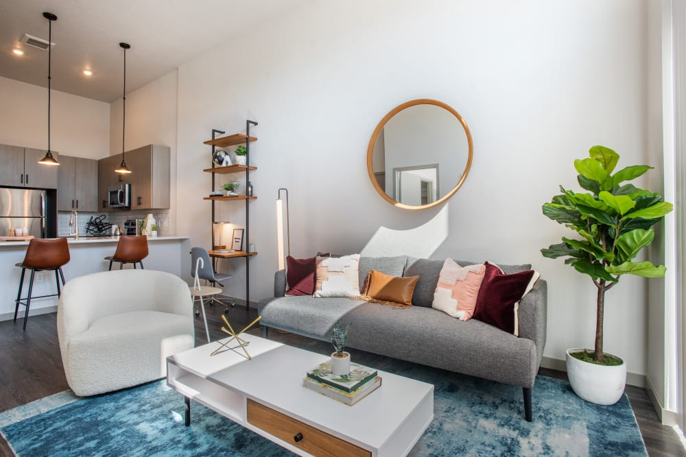 Well decorated, bright living room at Marq Iliff Station in Aurora, Colorado