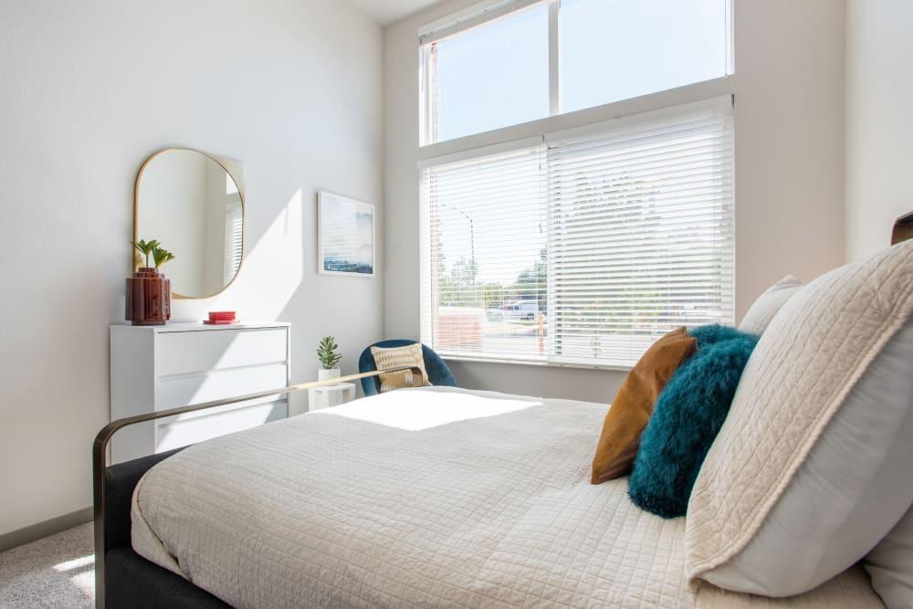 Cozy bedroom at Marq Iliff Station in Aurora, Colorado