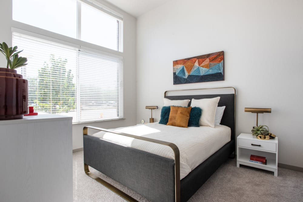 Bedroom with large windows at Marq Iliff Station in Aurora, Colorado