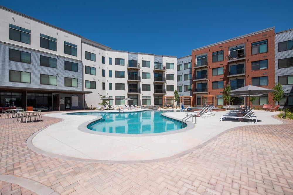 Resort-style swimming pool at Marq Iliff Station in Aurora, Colorado