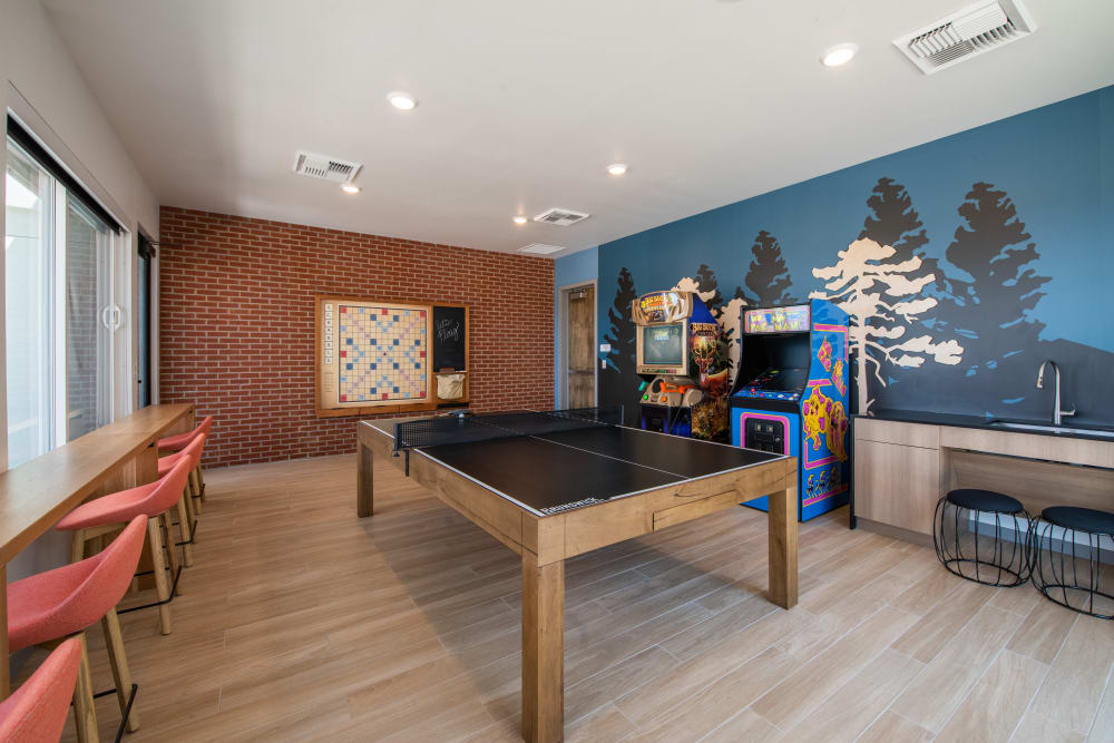 Game room with ping pong at Marq Iliff Station in Aurora, Colorado