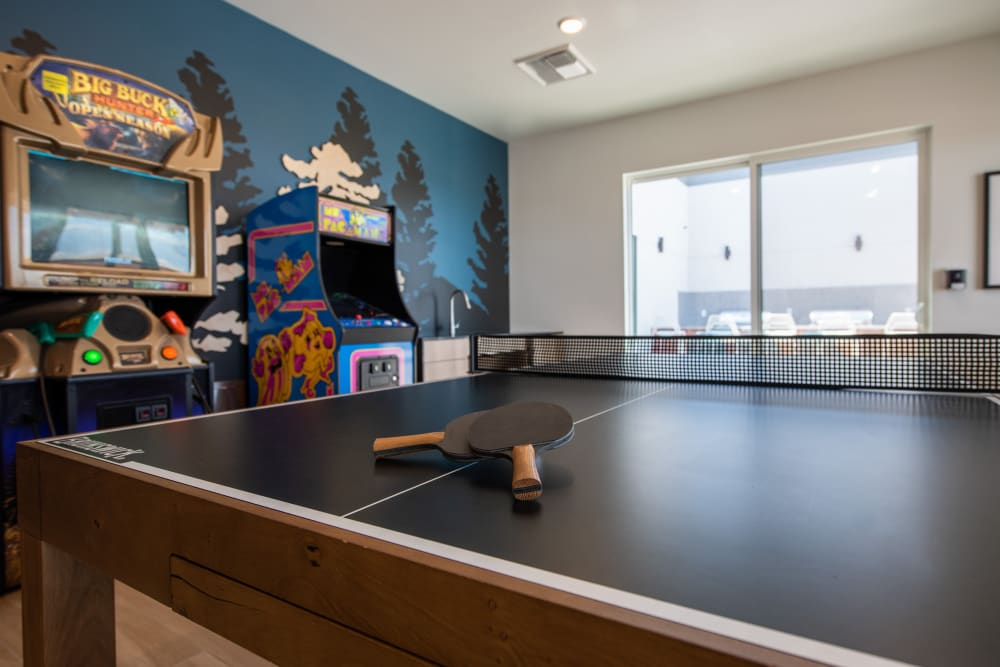 Ping pong table and arcade cabinets at Marq Iliff Station in Aurora, Colorado