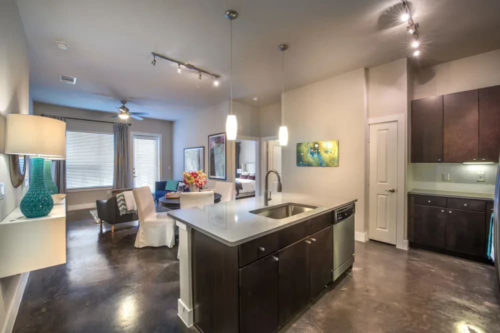 Spacious kitchen with big island with lots of extra counter space at Macallan at Ross in Dallas, Texas