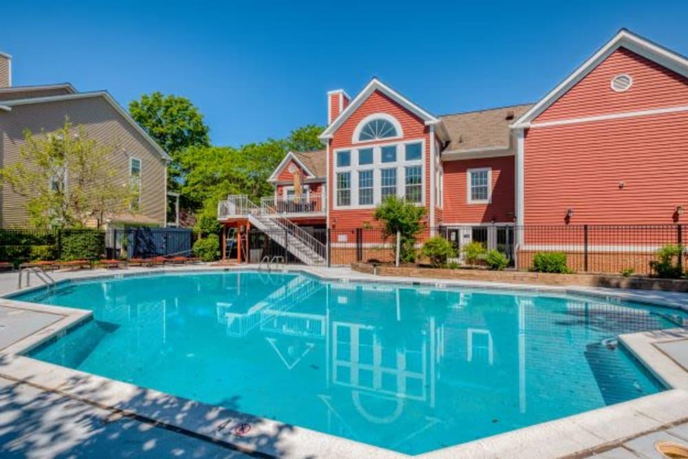 Refreshing swimming pool at Abbotts Run Apartments in Alexandria, Virginia