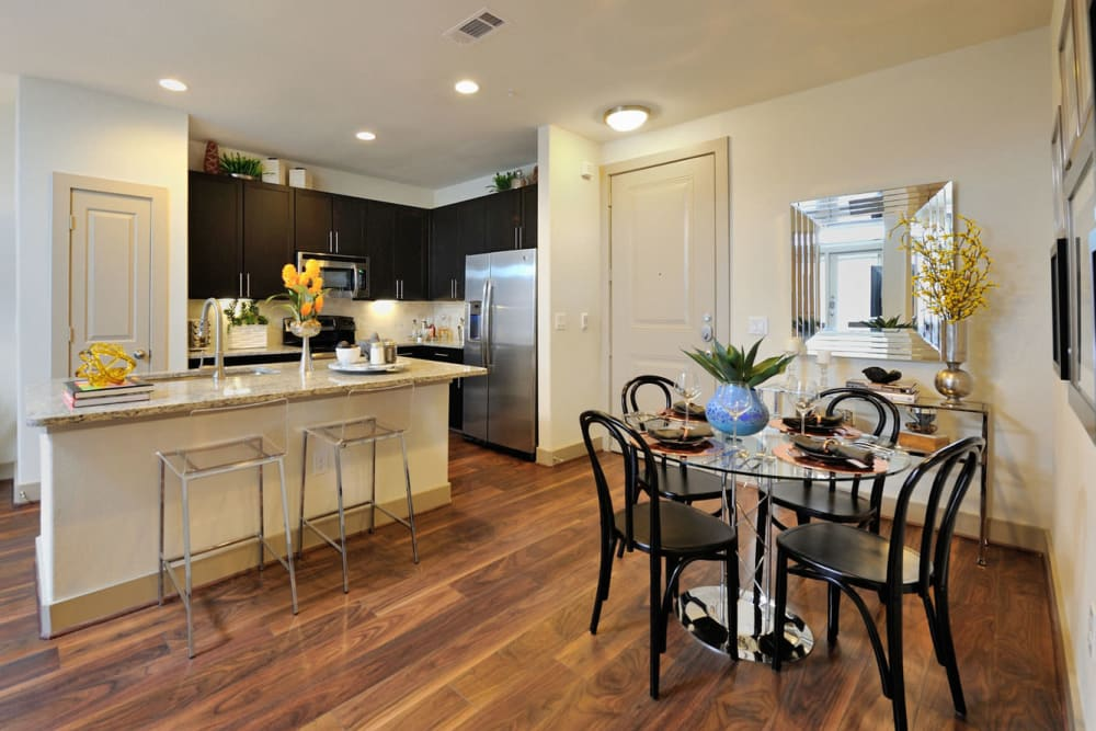 Dining table and counter island with bar stool chairs at Olympus Falcon Landing in Katy, Texas