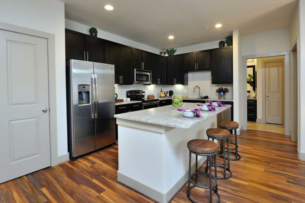 Counter island with bar stools at Olympus Falcon Landing in Katy, Texas