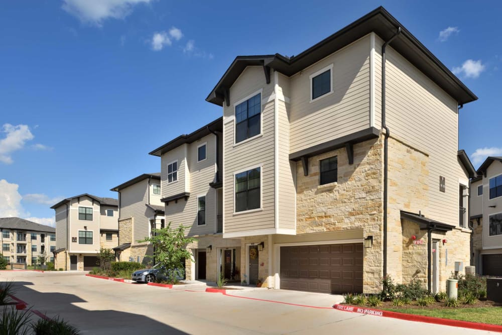 Unit exteriors with garages at Olympus Falcon Landing in Katy, TX