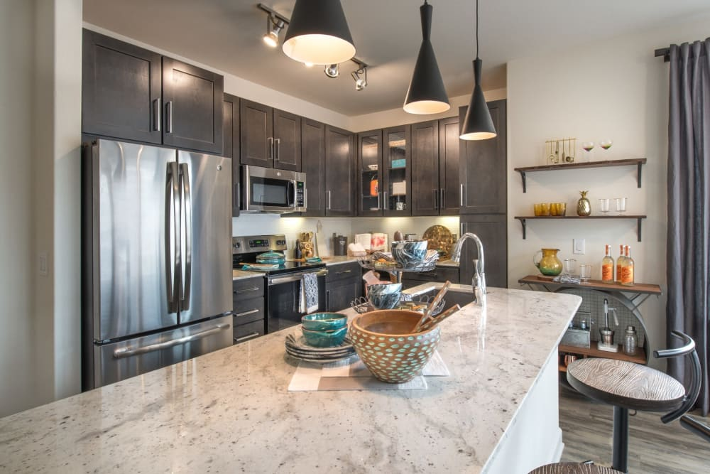 Gorgeous modern kitchen with tile style counters at Mercantile River District in Fort Worth, Texas