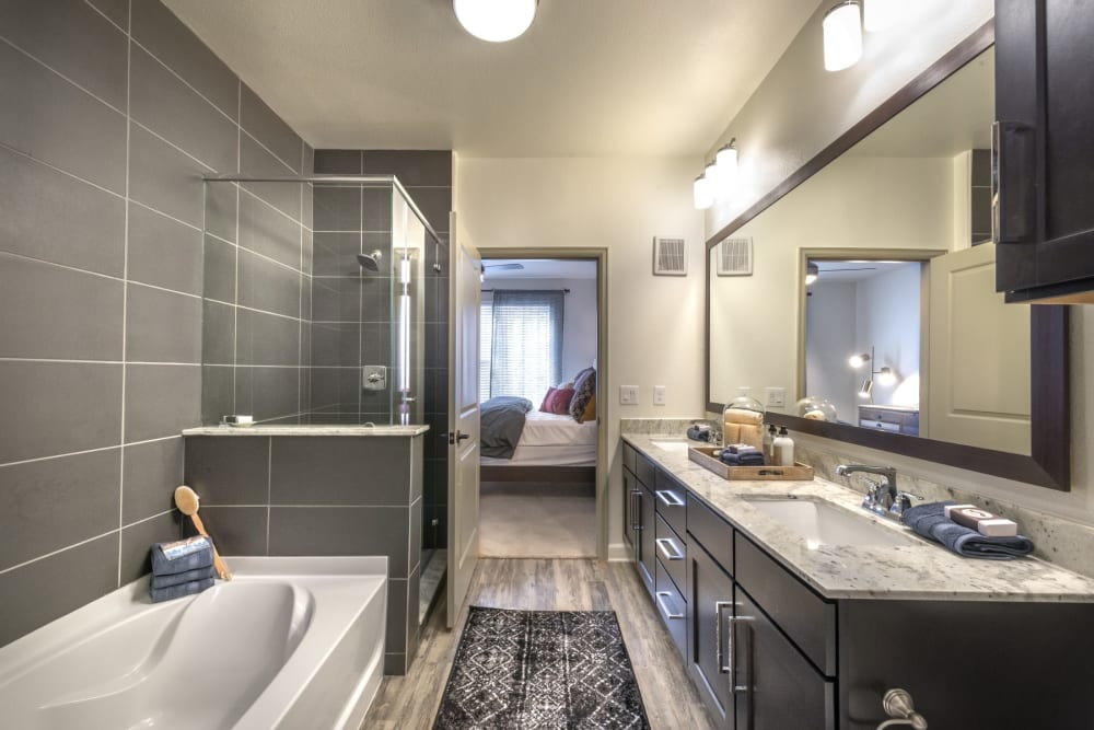 Large bathroom with a huge mirror at Mercantile River District in Fort Worth, Texas
