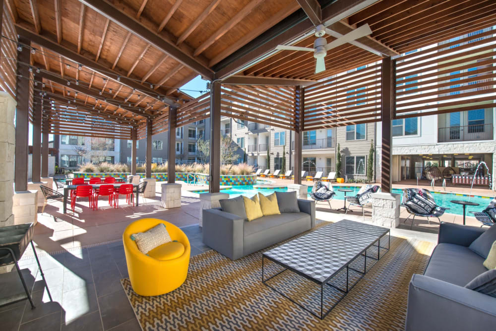 Large covered lounge area by the pool at Mercantile River District in Fort Worth, Texas
