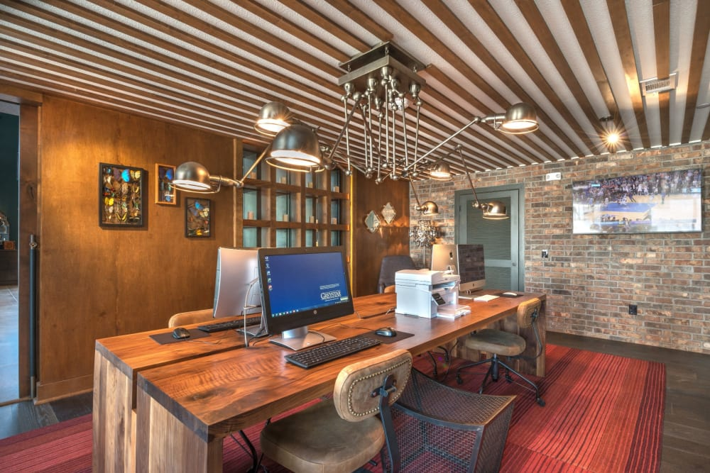 Office area in the clubhouse for residents to work in at Mercantile River District in Fort Worth, Texas