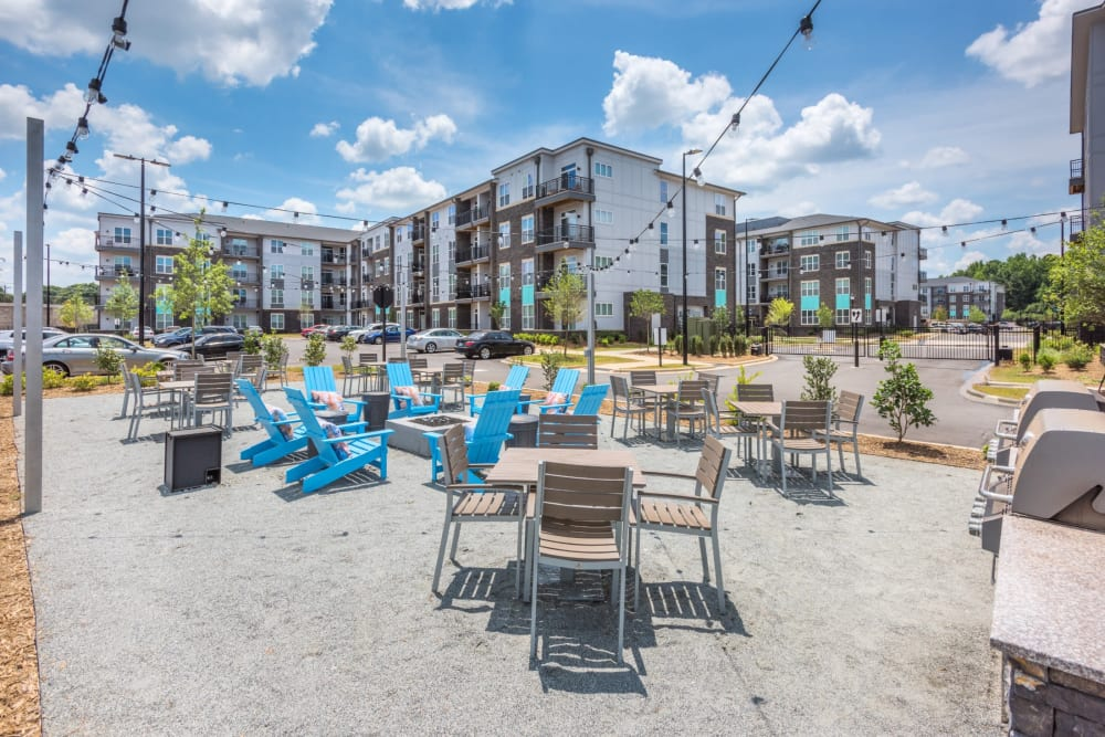 Tons of seating out by the pool for residents to eat or relax in at Blu at Northline Apartments in Charlotte, North Carolina