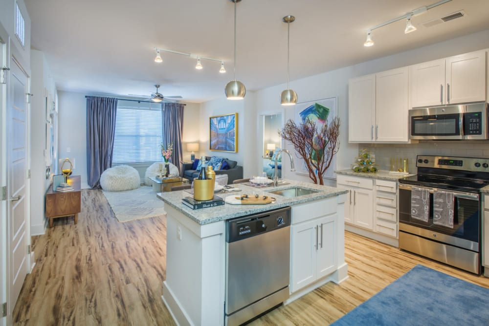 Large kitchen area with an island for extra counter space at Blu at Northline Apartments in Charlotte, North Carolina
